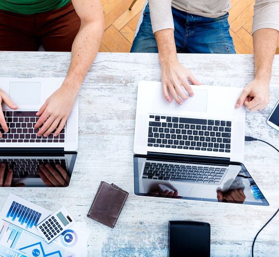 Two people are working on digital marketing strategy